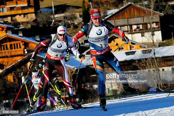 Evgeniy Garanichev of Russia takes 1st place during the IBU Biathlon World Cup Men's Relay on December 13, 2013 in Annecy-Le Grand Bornand, France.