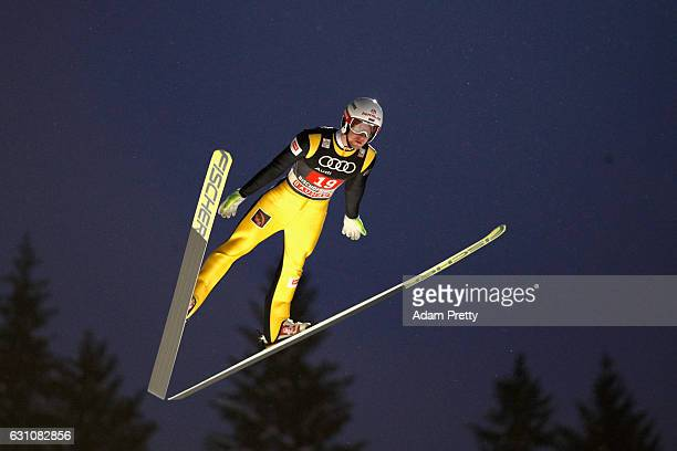 Evgeniy Klimov of Russia competes at the first round on Day 2 of the 65th Four Hills Tournament ski jumping event at PaulAusserleitnerSchanze on...
