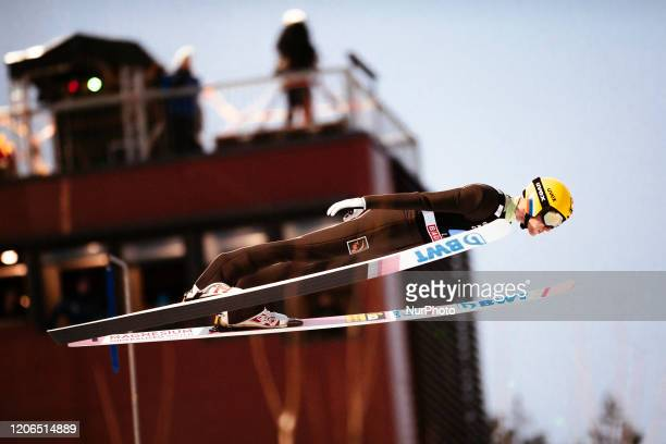 Evgeniy Klimov soars in the air during the men's large hill team competition HS130 of the FIS Ski Jumping World Cup in Lahti, Finland, on February...