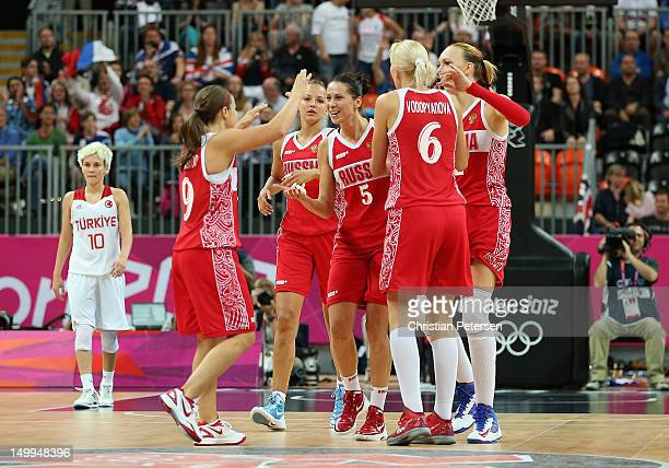 Evgeniya Belyakova of Russia celebrates with Becky Hammon and Natalia Vodopyanova after defeating Turkey in the Women's Basketball quaterfinal on Day...
