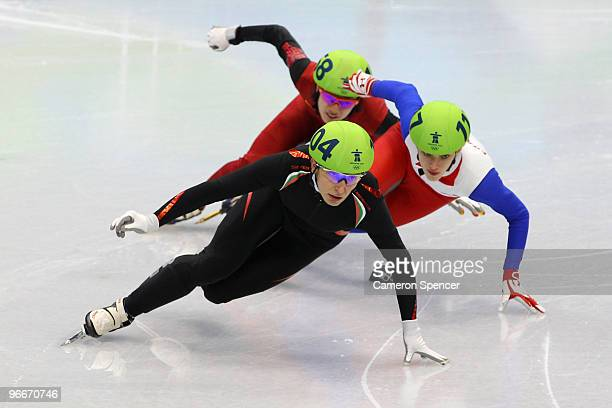 Evgeniya Radanova of Bulgaria leads Veronique Pierron of France and Nannan Zhao of China in the Ladies' 500 m Short Track on day 2 of the Vancouver...