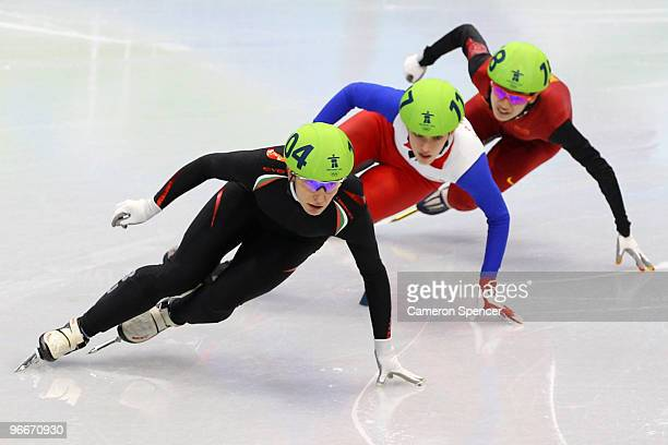 Evgeniya Radanova of Bulgaria leads Veronique Pierron of France and Nannan Zhao of China on day 2 of the Vancouver 2010 Winter Olympics at Pacific...