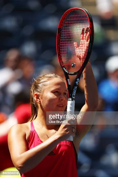 Evgeniya Rodina of Russia celebrates defeating Eugenie Bouchard of Canada after their first round Women's Singles match on Day Three of the 2017 US...