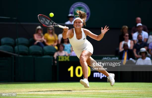 Evgeniya Rodina of Russia plays a forehand against Serena Williams of the United States during their Ladies' Singles fourth round match on day seven...