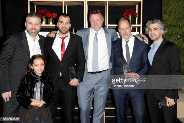 Evgeny Afineevsky Bana alAbed Hamoud AlMousa Nick Quested Sebastian Junger and Firas Fayyad pose with the Courage Under Fire award at the 33rd Annual...