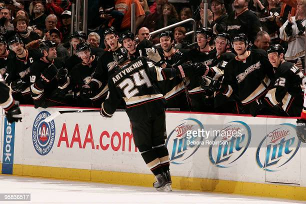 Evgeny Artyukhin of the Anaheim Ducks celebrates with the teammates on the bench his first period goal against the Calgary Flames during the game on...