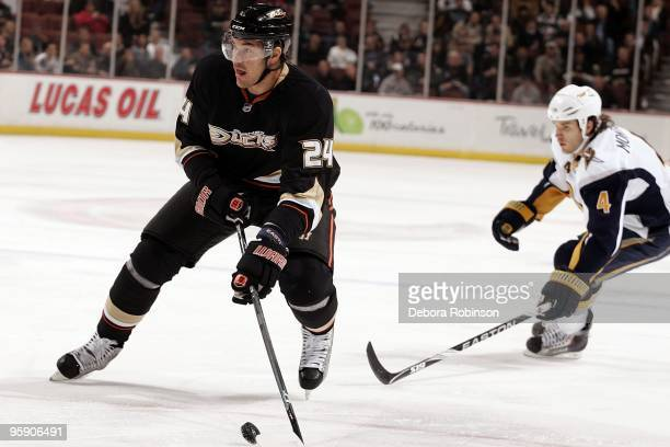 Evgeny Artyukhin of the Anaheim Ducks controls the puck center ice against the Buffalo Sabres during the game on January 19 2010 at Honda Center in...