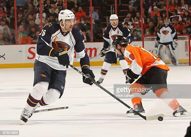 Evgeny Artyukhin of the Atlanta Thrashers skates down the ice against the Philadelphia Flyers on his way to scoring at the Wachovia Center on March...