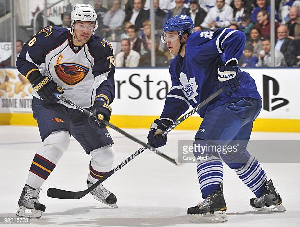 Evgeny Artyukhin of the Atlanta Thrashers skates with Luke Schenn of the Toronto Maple Leafs during the game on March 30 2010 at the Air Canada...