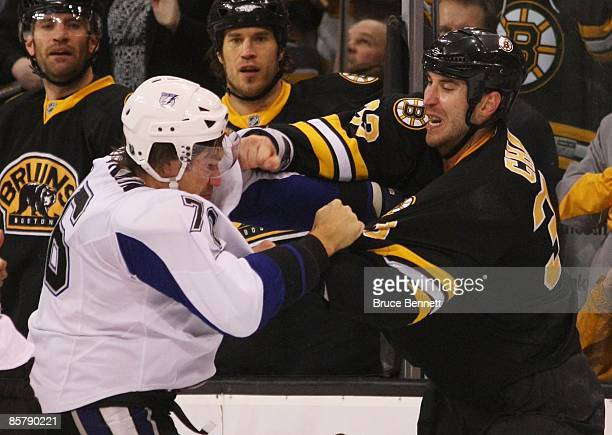 Evgeny Artyukhin of the Tampa Bay Lightning and Zdeno Chara of the Boston Bruins exchange blows on March 31 2009 at the TD Banknorth Garden in Boston