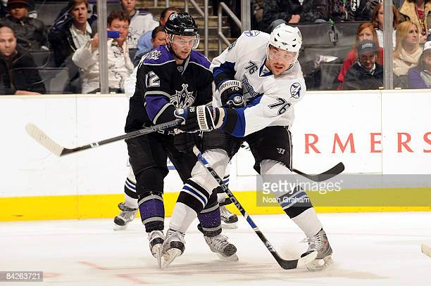 Evgeny Artyukhin of the Tampa Bay Lightning fights for position against Patrick O'Sullivan of the Los Angeles Kings during the game on January 12...