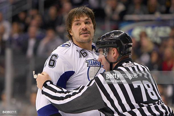 Evgeny Artyukhin of the Tampa Bay Lightning is held back by a referee against the Los Angeles Kings on January 12 2009 at the Staples Center in Los...