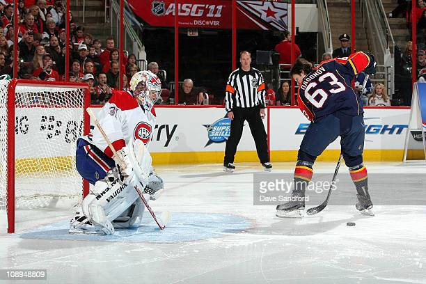 Evgeny Dadonov of the Florida Panthers competes against Carey Price of the Montreal Canadiens during the Honda NHL Superskills part of the 2011 NHL...