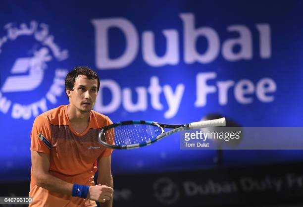 Evgeny Donskoy of Russia celebrates winning his second round match against Roger Federer of Switzerland on day four of the ATP Dubai Duty Free Tennis...