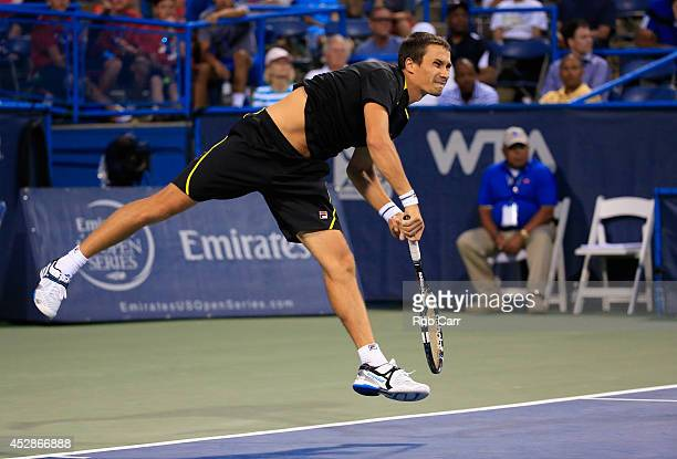 Evgeny Donskoy of Russia follows his serve to Francis Tiafoe of the United States during the Citi Open at the William HG FitzGerald Tennis Center on...