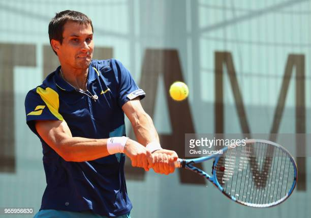 Evgeny Donskoy of Russia plays a backhand against Stefanos Tsitsipas of Greece in their first round match during day four of the Mutua Madrid Open...