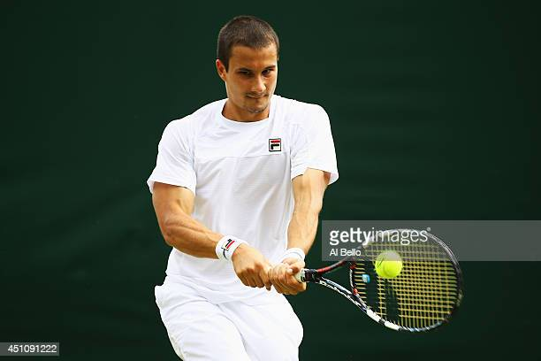 Evgeny Donskoy of Russia plays a backhand during his Gentlemen's Singles first round match against Bernard Tomic of Australia on day one of the...