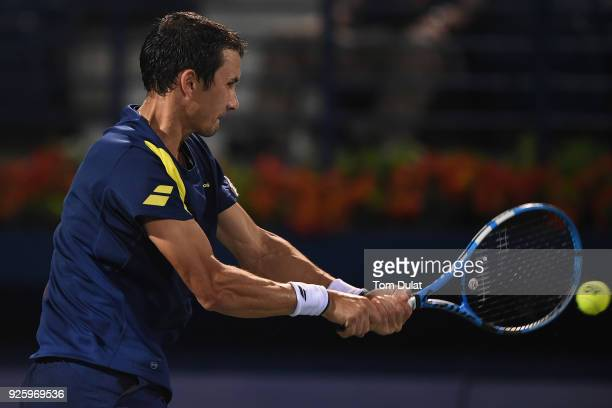 Evgeny Donskoy of Russia plays a backhand during his quarter final match against Filip Krajinovic of Serbia on day four of the ATP Dubai Duty Free...