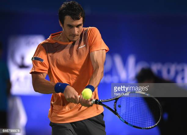 Evgeny Donskoy of Russia plays a backhand during his second round match against Roger Federer of Switzerland on day four of the ATP Dubai Duty Free...