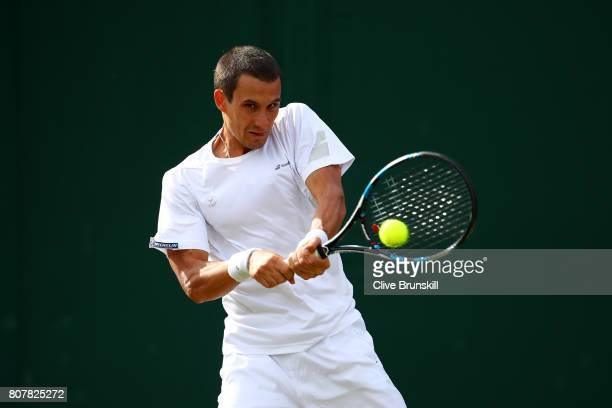 Evgeny Donskoy of Russia plays a backhand during the Gentlemen's Singles first round match against Alexander Zverev of Germany on day two of the...