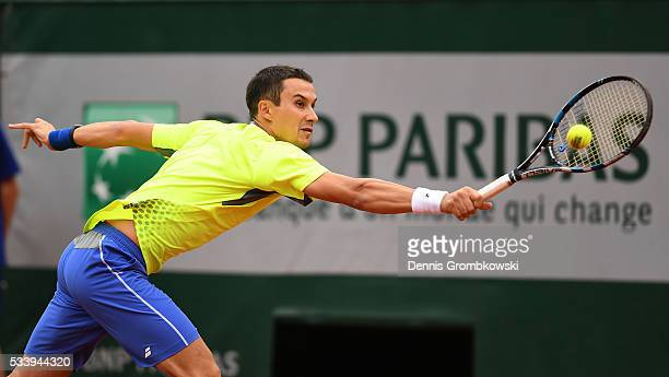 Evgeny Donskoy of Russia plays a backhand during the Men's Singles first round match against David Ferrer of Spain on day three of the 2016 French...