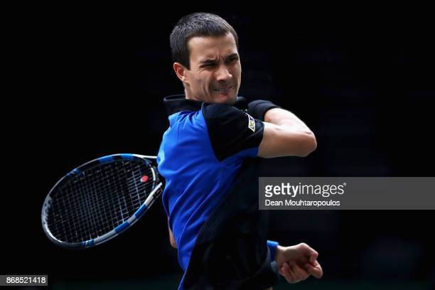 Evgeny Donskoy of Russia plays a forehand against Kyle Edmund of Great Britain during Day 2 of the Rolex Paris Masters held at the AccorHotels Arena...
