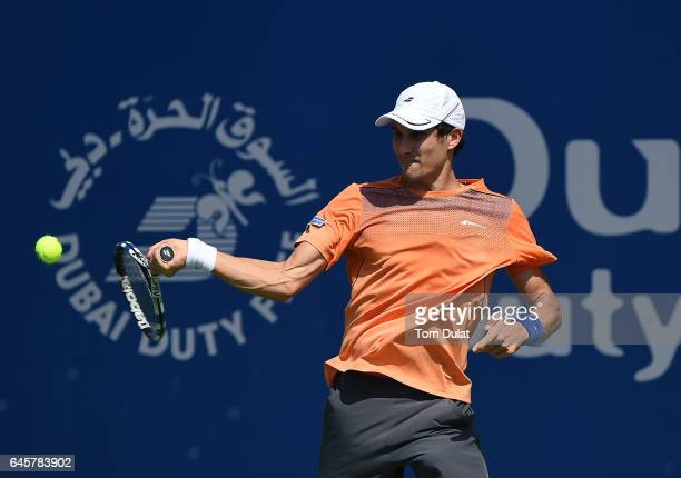 Evgeny Donskoy of Russia plays a forehand during his match against James McGee of Ireland on day two of the Dubai Duty Free Tennis Championship on...