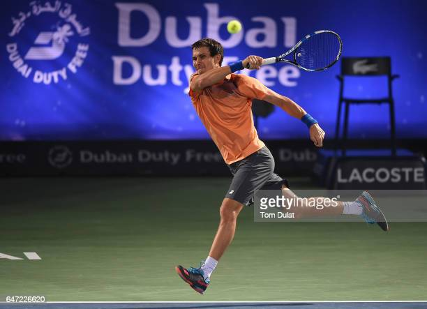 Evgeny Donskoy of Russia plays a forehand during his quarter final match against Lucas Pouille of France on day five of the ATP Dubai Duty Free...