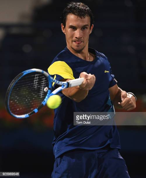 Evgeny Donskoy of Russia plays a forehand during his quarter final match against Filip Krajinovic of Serbia on day four of the ATP Dubai Duty Free...