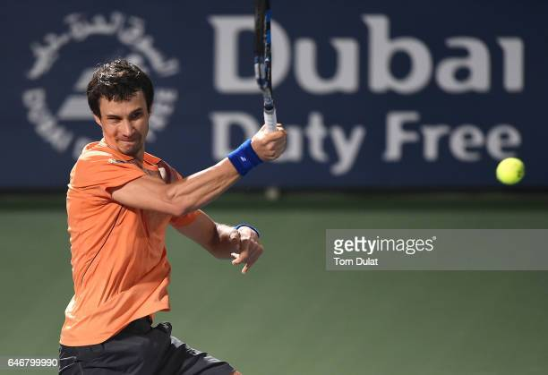 Evgeny Donskoy of Russia plays a forehand during his second round match against Roger Federer of Switzerland on day four of the ATP Dubai Duty Free...