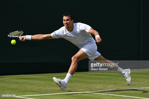 Evgeny Donskoy of Russia plays a forehand shot during the Men's Singles first round against Alexandr Dolgopolov of Ukraine on day one of the...