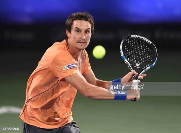 Evgeny Donskoy of Russia plays a volley during his quarter final match against Lucas Pouille of France on day five of the ATP Dubai Duty Free Tennis...