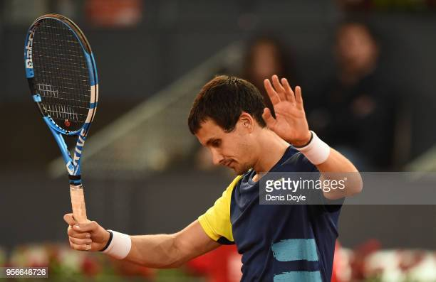 Evgeny Donskoy of Russia reacts after his shot hit the net before going over the other side in his 2nd Round match against Alexander Zverev of...