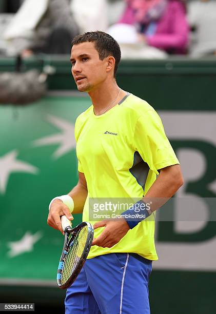 Evgeny Donskoy of Russia reacts during the Men's Singles first round match against David Ferrer of Spain on day three of the 2016 French Open at...