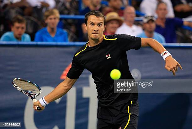 Evgeny Donskoy of Russia returns a shot to Francis Tiafoe of the United States during the Citi Open at the William HG FitzGerald Tennis Center on...