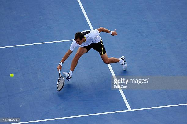 Evgeny Donskoy of Russia returns a shot to Kevin Anderson of South Africa during the Citi Open at the William HG FitzGerald Tennis Center on July 29...