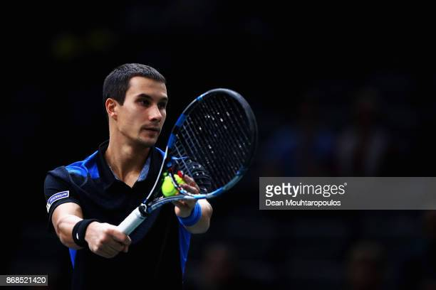 Evgeny Donskoy of Russia serves against Kyle Edmund of Great Britain during Day 2 of the Rolex Paris Masters held at the AccorHotels Arena on October...