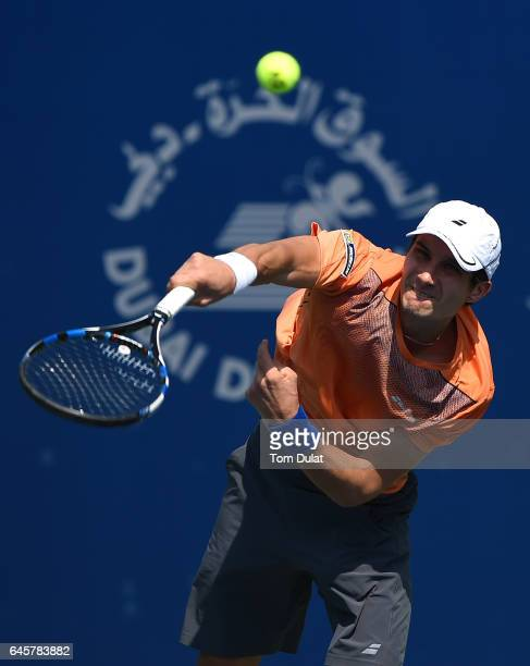 Evgeny Donskoy of Russia serves during his match against James McGee of Ireland on day two of the Dubai Duty Free Tennis Championship on February 27...