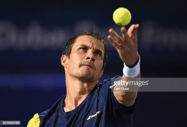 Evgeny Donskoy of Russia serves during his quarter final match against Filip Krajinovic of Serbia on day four of the ATP Dubai Duty Free Tennis...