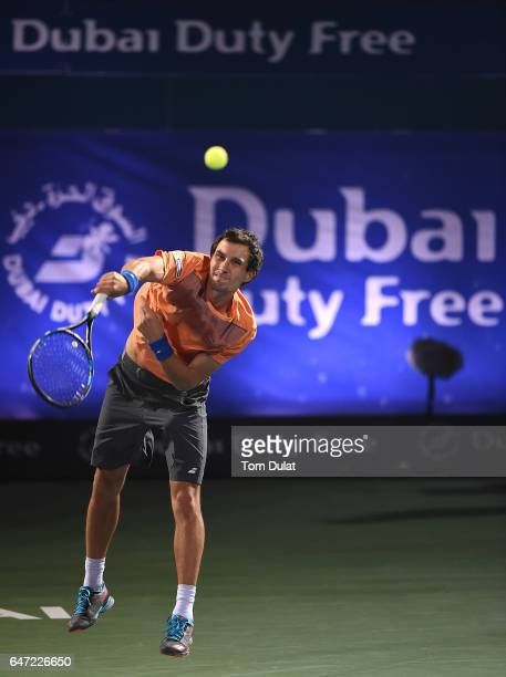 Evgeny Donskoy of Russia serves during his quarter final match against Lucas Pouille of France on day five of the ATP Dubai Duty Free Tennis...