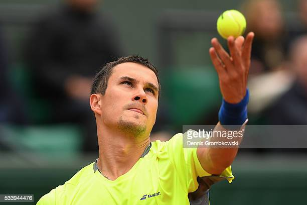 Evgeny Donskoy of Russia serves during the Men's Singles first round match against David Ferrer of Spain on day three of the 2016 French Open at...