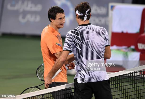 Evgeny Donskoy of Russia smiles after beating Roger Federer of Switzerland during his second round match on day four of the ATP Dubai Duty Free...