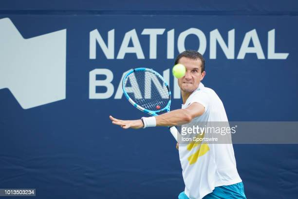 Evgeny Donskoy returns the ball during his first round match of the Rogers Cup tennis tournament on August 6 at Aviva Centre in Toronto ON Canada