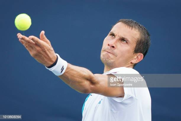 Evgeny Donskoy seves the ball during his first round match of the Rogers Cup tennis tournament on August 6 at Aviva Centre in Toronto ON Canada