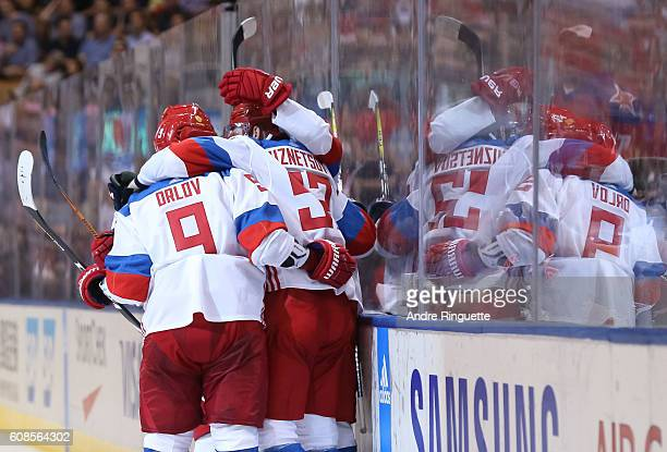 Evgeny Kuznetsov celebrates with Dmitry Orlov of Team Russia after scoring a second period goal on Team North America during the World Cup of Hockey...