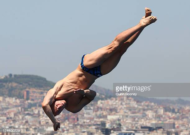 Evgeny Kuznetsov of Russia competes in the Men's 3m Springboard Diving semi final on day six of the 15th FINA World Championships at Piscina...