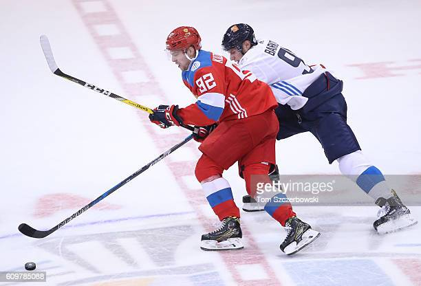 Evgeny Kuznetsov of Team Russia tries to control the puck as he is pressured by Aleksander Barkov of Team Finland during the World Cup of Hockey...