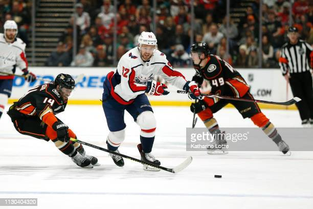 Evgeny Kuznetsov of the Washington Capitals and Adam Henrique of the Anaheim Ducks fight for control of the puck during the second period at Honda...