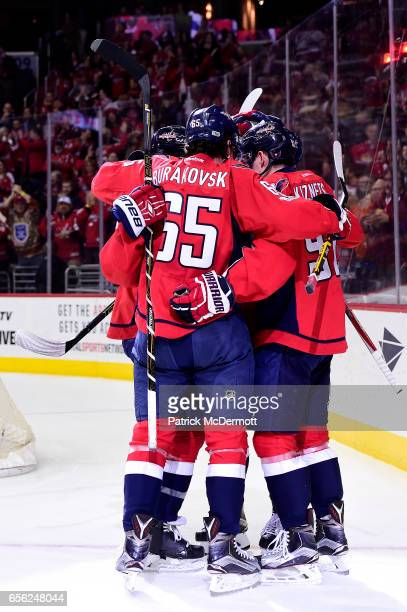 Evgeny Kuznetsov of the Washington Capitals celebrates his first period goal with his teammates during an NHL game against the Calgary Flames at...