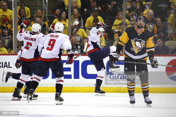 Evgeny Kuznetsov of the Washington Capitals celebrates his overtime winning goal to win the series against the Pittsburgh Penguins in Game Six of the...
